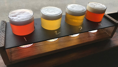 A flight of La Cabra beer